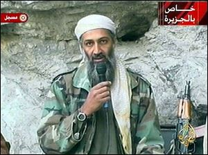This image made from video broadcast on Sunday, Oct. 7, 2001 shows Osama bin Laden at an undisclosed location.