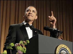President Barack Obama starts his speech at the White House Correspondents' Association Dinner in Washington, D.C.