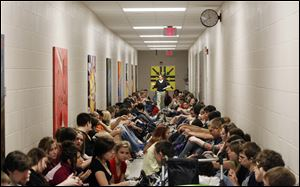 Teacher Christa Leopold counts the students lining a hallway of Maumee High School during a tornado warning. The 17 tornadoes in Ohio so far in 2011 have surpassed the state's annual average of 15.