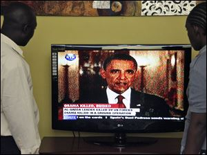 Kenyans watch U.S. President Barrack Obama,on television in Nairobi, Kenya, announcing the death of Osama bin Laden in Pakistan.