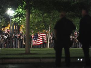 Secret Service Police watch the crowd celebrating outside the White House in Washington early Monday.
