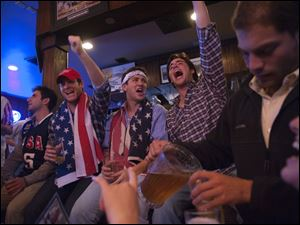 University of Texas at Austin students celebrate the news of Osama Bin Laden's death at Cain & Abel's bar late Sunday night.