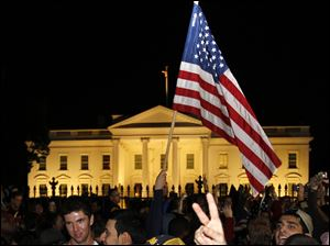 Crowds celebrate on Pennsylvania Avenue in front of the White House in Washington