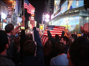 A crowd gathered in New York's Times Square reacts to the news of Osama Bin Laden's death early Monday morning.