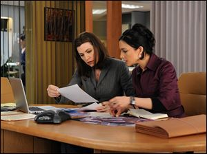 Alicia (Julianna Margulies), left, and Kalinda (Archie Panjabi) were friends before Alicia learned of her husband's affair with Kalinda.