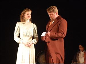 The scene is Inspector Ruffing (Jason Wells-Jensen) questions Gillian Ravenscroft (Grace Easterly) in a scene from the Black Swamp Players' production of 'Ravenscroft.'