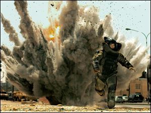 Jeremy Renner runs from an exploding bomb in the Oscar-winning movie 'The Hurt Locker,' which took place in Iraq.
