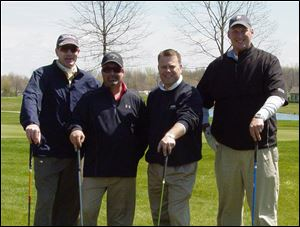The team of Burt Jamieson, Tim Medley, Tab Hinkle, and Jake Holmes won the Ottawa County United Way Golf Invitational.