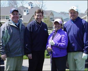 Gordon MacRitchie, Bill Kitson, Alison Falls, and Tom Manahan at the Ottawa County United Way Golf Invitational.