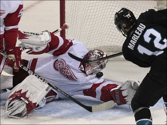 Patrick Marleau Jimmy Howard Detroit Red Wings goalie Jimmy Howard (35) blocks a shot from San Jose Sharks center Patrick Marleau (12) in the second period in Game 2 in the NHL hockey Stanley Cup playoffs Western Conference semifinal in San Jose, Calif..