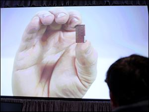 A 3-D tri-gate transistor is shown on a video at an Intel announcement that it redesigned the electronic switches on its chips.