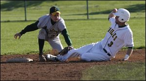 Start's Justin Cannon tags out Clay's Austin Achter at second base in Wednesday's game. The win keeps Clay in the City League title chase with a 4-1 league mark. Cannon had an RBI in the loss.