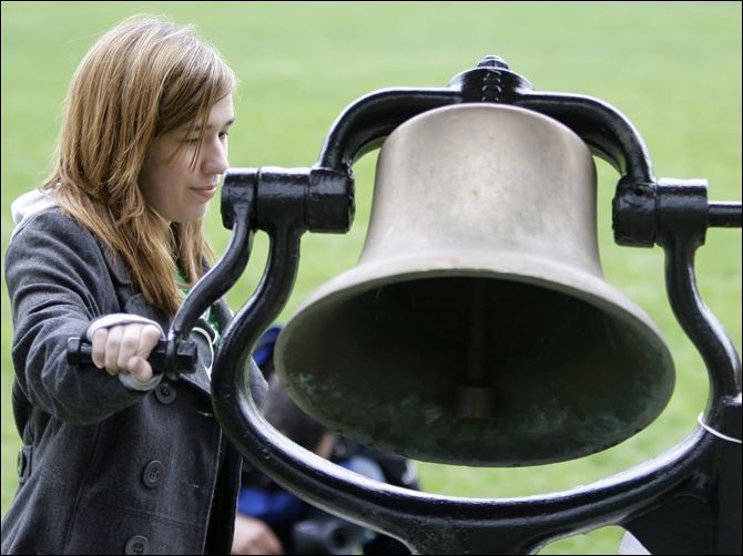 Kent State Halie Doyle Victory Bell Halie Doyle, 16, rings the Victory Bell at Kent State University during commemoration services Wednesday for the four students who were killed May 4, 1970, at Kent State during Vietnam war protests.