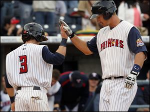 Toledo's Ryan Strieby, right, high fives Will Rymes after hitting a home run during the third inning against Charlotte.