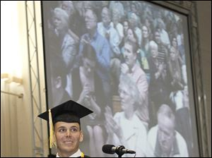 Air Force Staff Sgt. Joshua Falso smiles after giving his commencement speech during graduation at Bowling Green State University in Bowling Green, Ohio. Sergeant Falso attended BGSU online while serving in various states and countries, including Iraq and Kuwait.