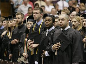 Graduates, including Antonio Montemaron, of Parma, right, and BG resident Bobby Carr, 2nd from right, are among the last class to graduate at the Anderson Arena.