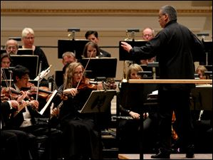 Members of the Toledo Symphony under the direction of Principal Conductor Stefan Sanderling perform in the Spring for Music festival Saturday at Carnegie Hall in New York.