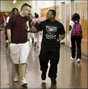Fred Hitt, left, and Denzel Moore, students at Scott High School, have defied the odds and overcome personal hardships as they pursue their educations in the Toledo Public School system.
