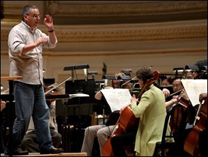 Conductor Stefan Sanderling runs through a rehearsal with the Toledo Symphony.