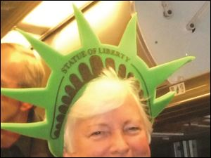 Sue Martin, a member of the Toledo delegation, takes time out for some fun and sightseeing in New York City.