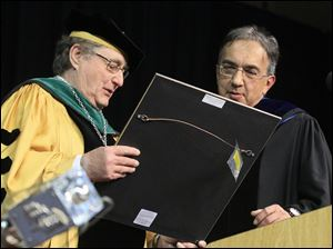 Dr. Lloyd Jacobs presents Sergio Marchionne with his honorary doctorate. The Chrysler CEO is a former accountant and barrister.
