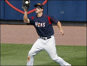 Toledo Mud Hens' Andy Dirks catches an outfield fly.
