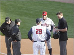 Toledo Mud Hens manager Phil Nevin (25) and Lehigh Valley IronPigs manager Ryne Sandberg meet with the umpires before their game at Fifth Third Field. The Mud Hens lost 1-0.