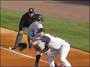 Mud Hens' first baseman Ryan Strieby catches a pickoff attempt as Lehigh Valley's Kevin Frandsen gets safely back to first.