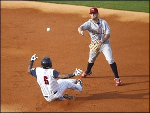 Toledo's Timo Perez tries to slide into second but is out while IronPigs second baseman Kevin Frandsen tries for the double play.