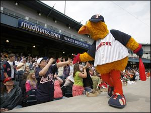 Muddy the Mud Hen greets school children at Fifth Third Field as the Toledo Mud Hens play the Lehigh Valley IronPigs on Tuesday.