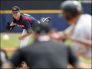 Toledo Mud Hens pitcher Adam Wilk strikes out Lehigh Valley IronPigs player Rich Thompson in the second inning.