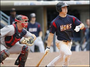 Toledo Mud Hens player Andy Dirks, 9, hits a single to score a run against the Lehigh Valley IronPigs during the ninth inning.