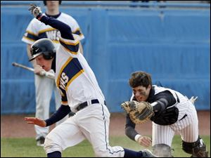 Whitmer's Alex Craig scores before Northview catcher Dalton Carter can apply a tag.