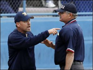 Whitmer coach Gary O'Connor argues with an umpire.