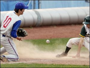Start's Jacob Cannon (23) steals third base ahead of a throw to St. Francis' Nate Opblinger (10).