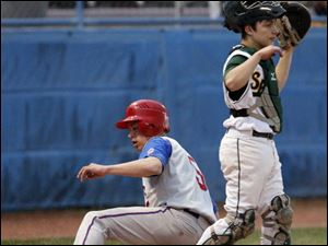 St. Francis' Tad Sobieszczanski scores while Start catcher Jacob Cannon waits for the throw.