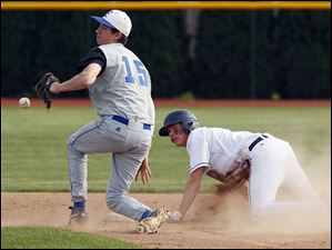 Lake's Kurt McKee (7) steals second base against  Elmwood's Kevin Hammer (15).