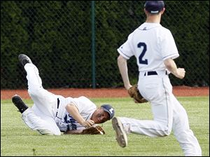 Lake's Corey Hotmer (11) makes a diving catch to make a play against Elmwood as Ryan Kohlhofer (2) covers the play.