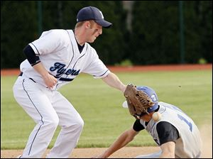 Lake's Casey Witt (5) drops the ball while attempting to tag Elmwood's Conlan Varty (10) at second base.