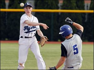 Lake's Tyan Kohlhofer (2) makes a play at second base against  Elmwood's Trey Marsh (5) during the fourth inning.