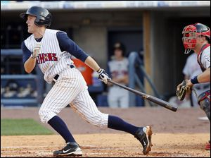 Toledo Mud Hens player Danny Worth hits a single to score Ben Guez against the Lehigh Valley Iron Pigs during the second inning.