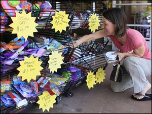Stacey Robin shops for discounted ribbons Wednesday at a Michaels store in Santa Clarita, Calif.