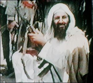 Osama bin Laden holds an AK47 automatic rifle in an image from an undated recruitment video tape for his organization, as viewed by The Associated Press in Kuwait City in 2001.