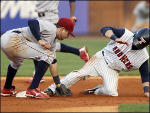 Mud Hens player Will Rhymes (3) slips past the tag attempt of IronPigs player Brian Bocock (13) to steal second base during the fourth inning.