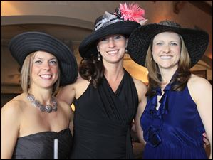 Amanda Brzuchalski, from left, Anna Meyer, and Danielle Gallagher enjoy Sylvania Country Club's Derby party.