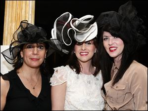 Gabrielle Vitellio, left, Michelle Henry, center, and Allison Parsons at the museum's Derby party.