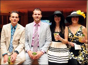 Matthew Wilbur, from left, Travis Wilbur, Kimberly Wilbur and Cathy Ringey at the Toledo Museum of Art's party for the Kentucky Derby.