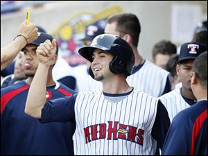 Toledo Mud Hens player Cale Iorg celebrates with teammates after scoring against Lehigh Valley.