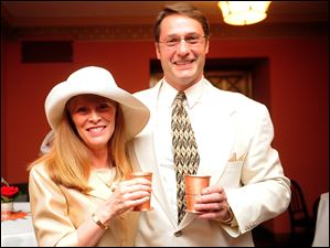 Cheryl and Kevin Ford enjoy a drink inside the VIP Room at the Toledo Museum of Art's Kentucky Derby party.
