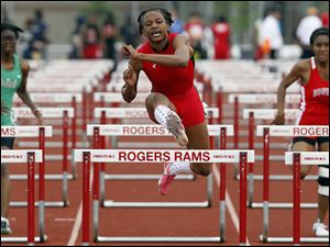 Brianna Scott-Glover of Rogers wins the 100 meter hurdles during the City League track meet.